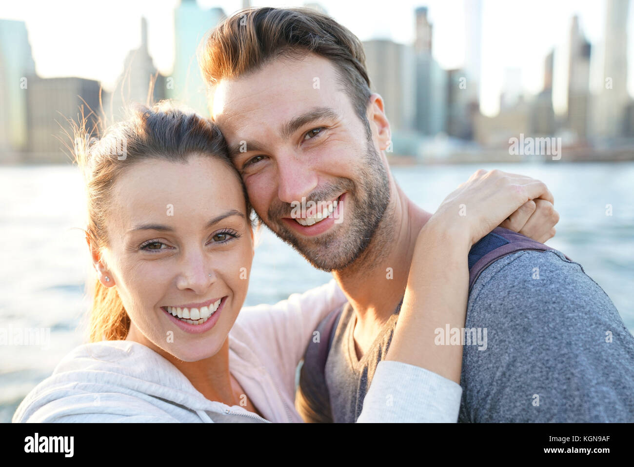 In love couple enjoying sunset on Brooklyn heights, NYC - Stock Image