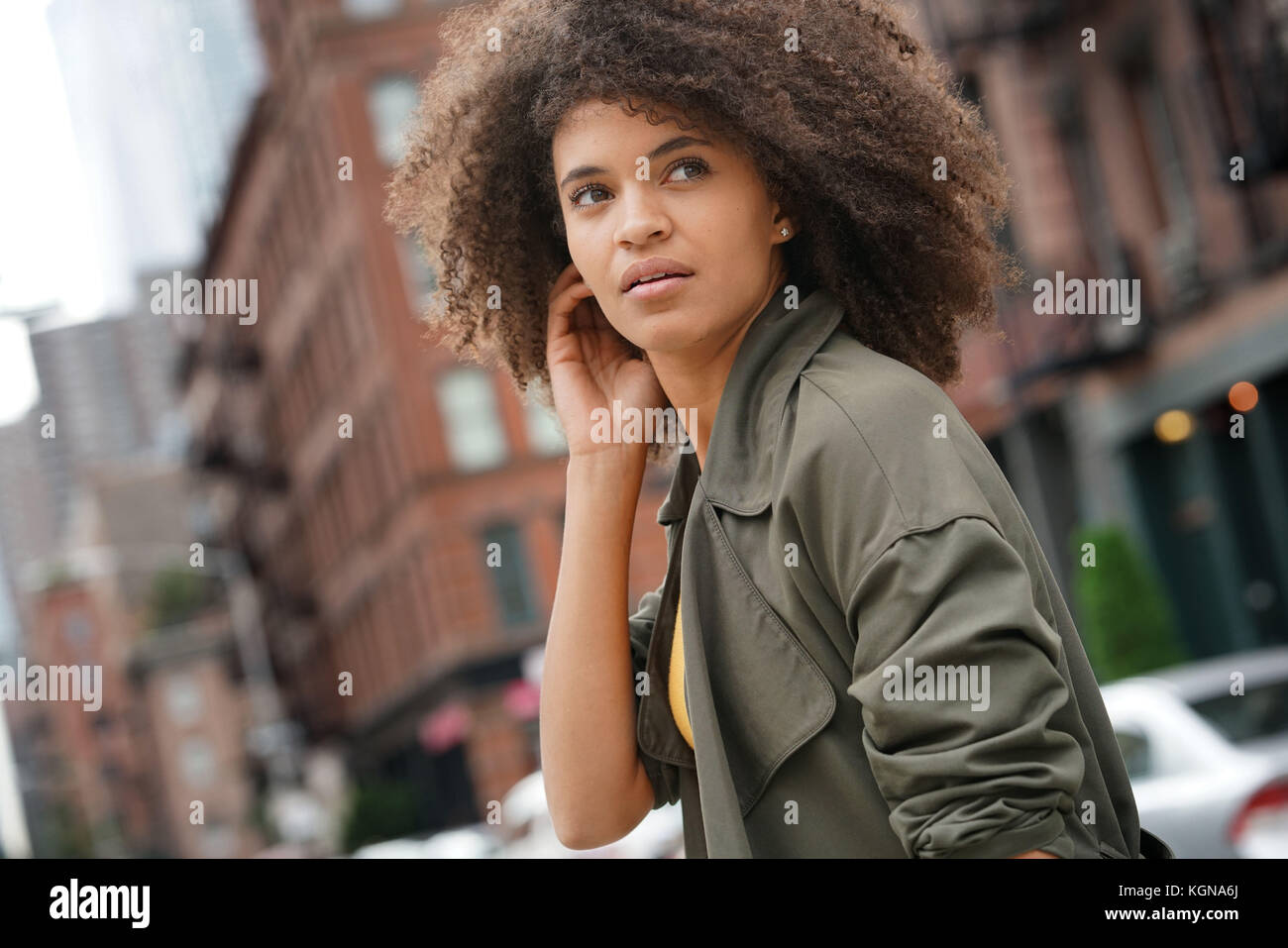Fancy city girl crossing the street, New York city - Stock Image