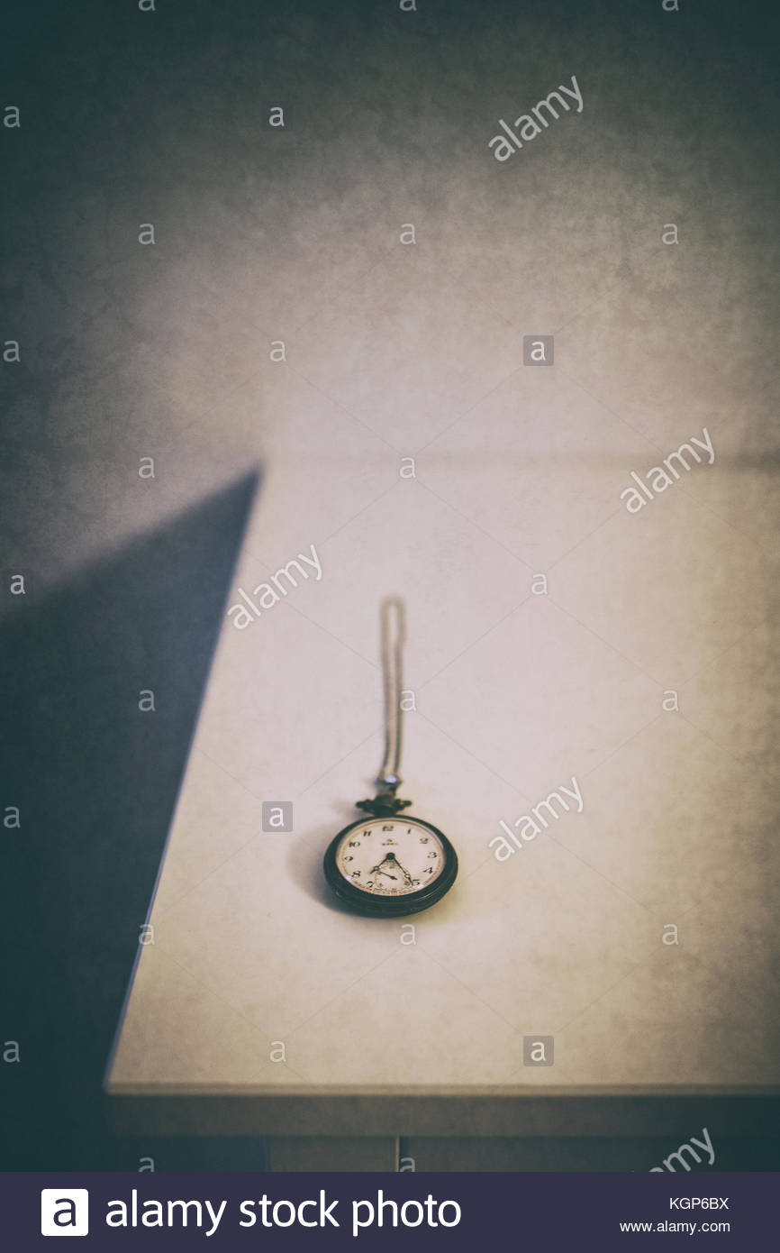 Old clock on a nighstand, eroded, vintage feel - Stock Image