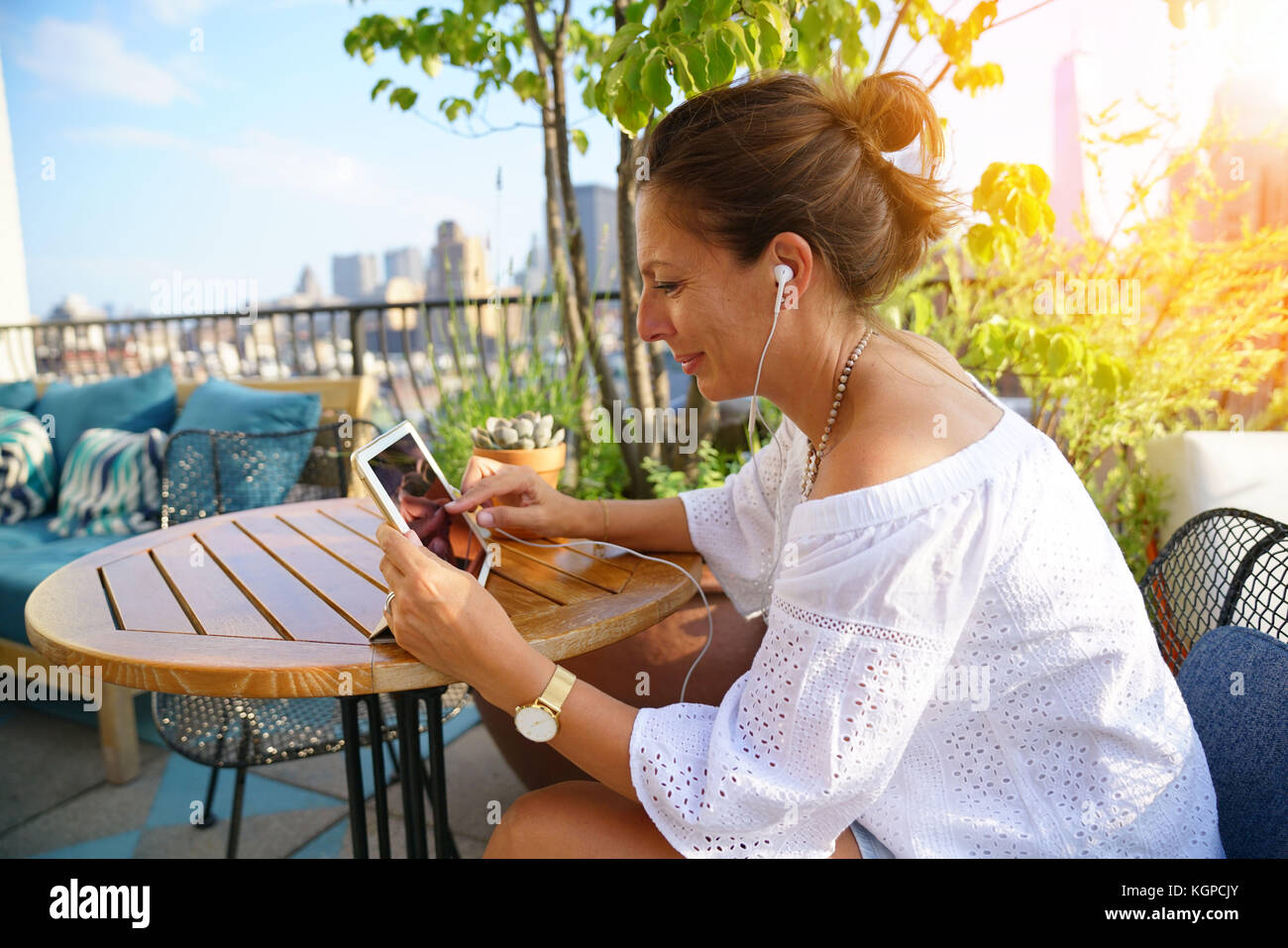 Woman connected with digital tablet having a conversation - Stock Image