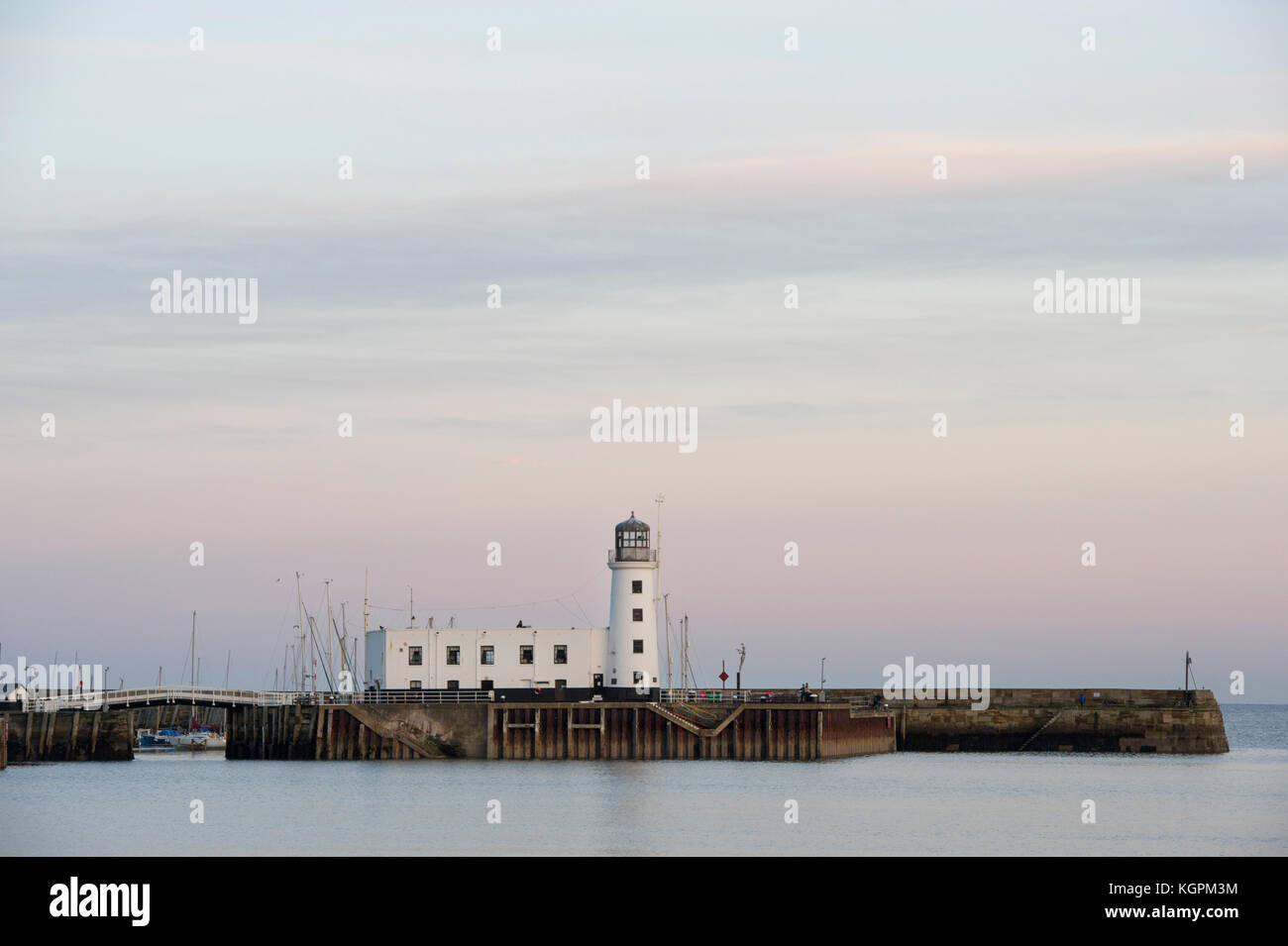 Scarborough Harbour and Lighthouse during an Autumn sunset on the North Yorkshire seaside town. - Stock Image