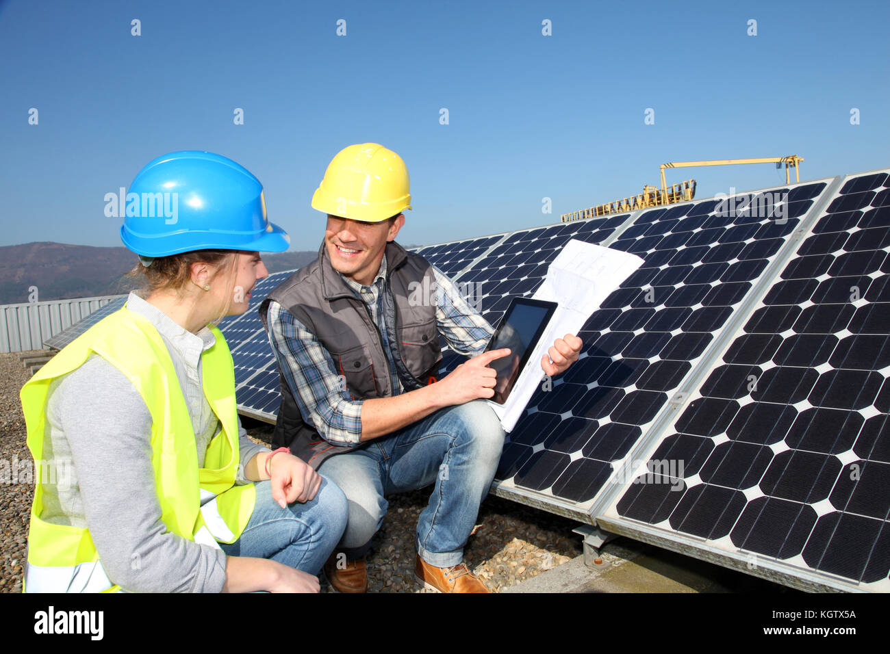 Man showing solar panels technology to student girl - Stock Image