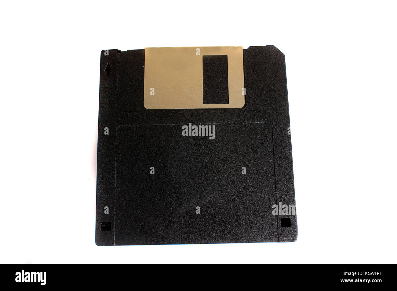 An old black floppy of 3.5 inch and storage of 1.44 MB used for storage. - Stock Image