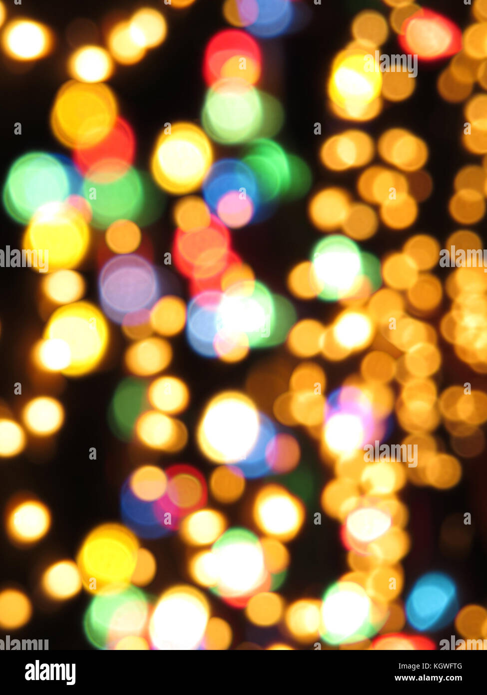 A beautiful background of blurred festive lights in various colors. - Stock Image