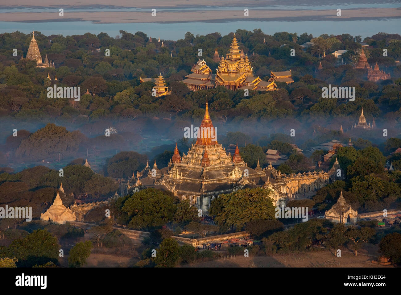 Aerial view of the early morning sunshine on the Ananda Buddhist Temple (foreground) in the ancient city of Bagan - Stock Image