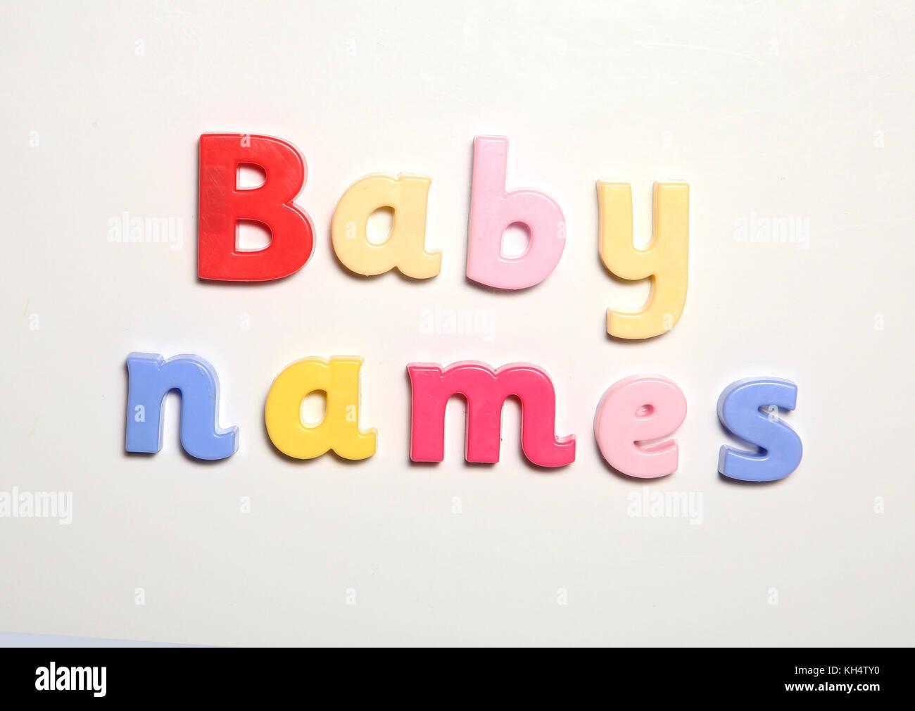 baby names spelt in magnet letters - Stock Image