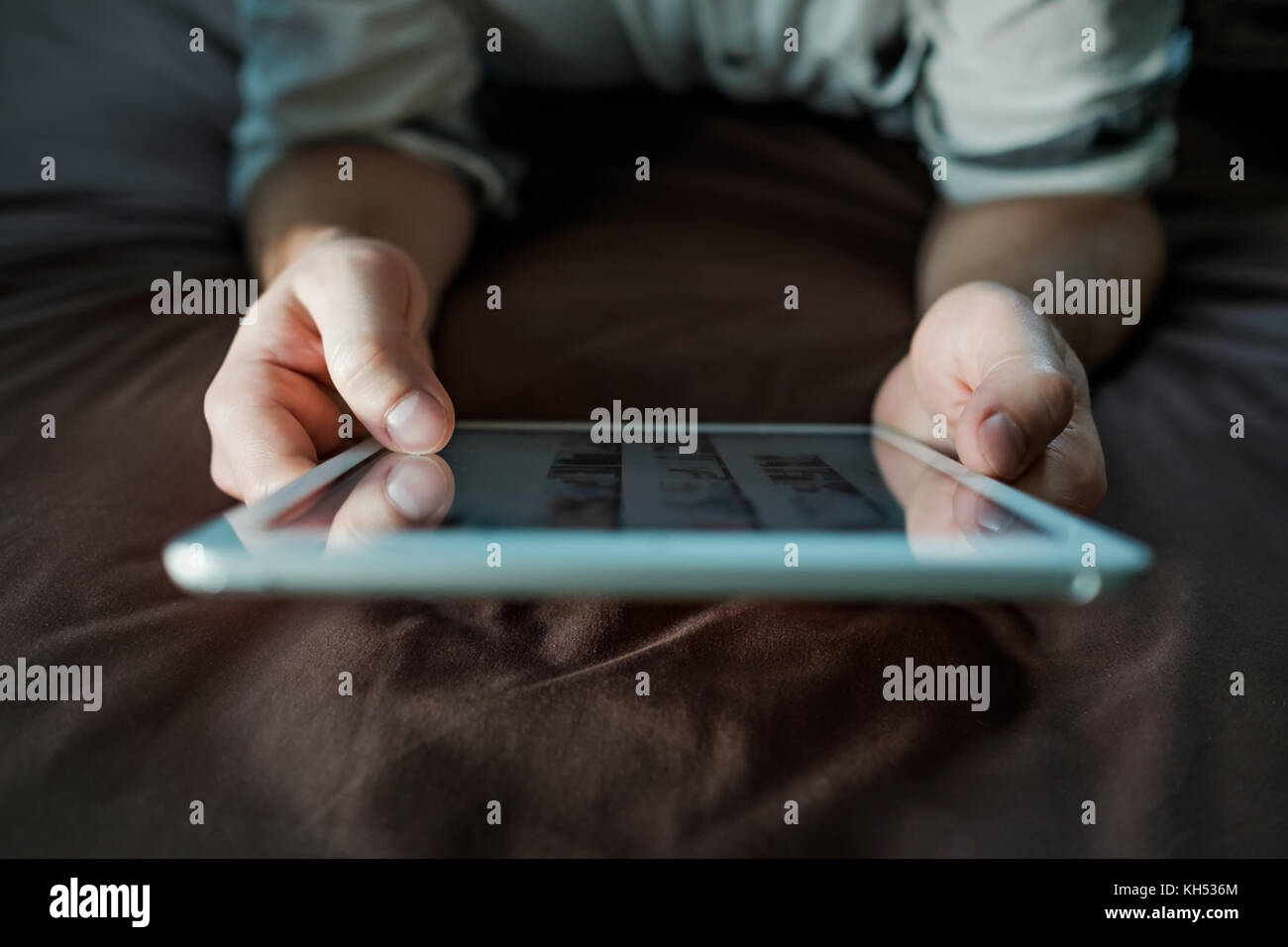 close up hands of caucasianman using tablet, connecting wifi. Up view. - Stock Image