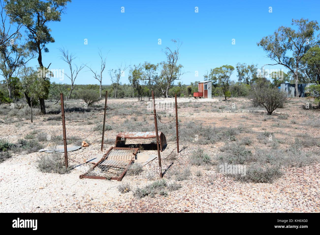 Abandoned Opal Mining shaft seen along the Green Car Door Tour Stock
