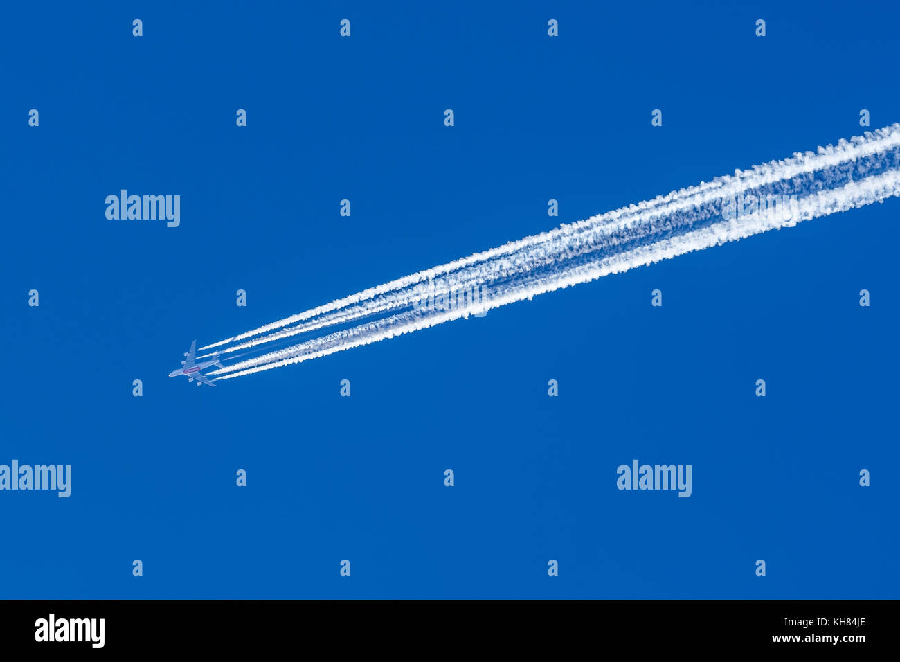 Contrails from Emirates Airbus A380 - France - Stock Image