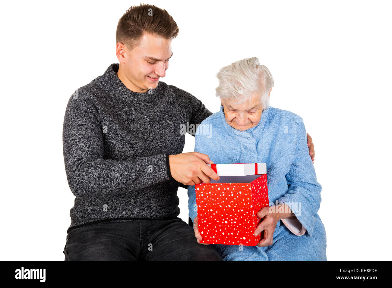 Picture Of An Old Lady Receiving Birthday Gifts From Her Grandson