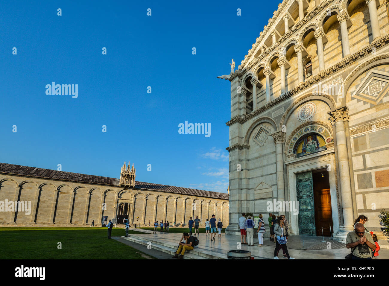The front of the Duomo, Pisa cathedral with the Campo Santo behind in the Field of Miracles in Pisa Italy - Stock Image