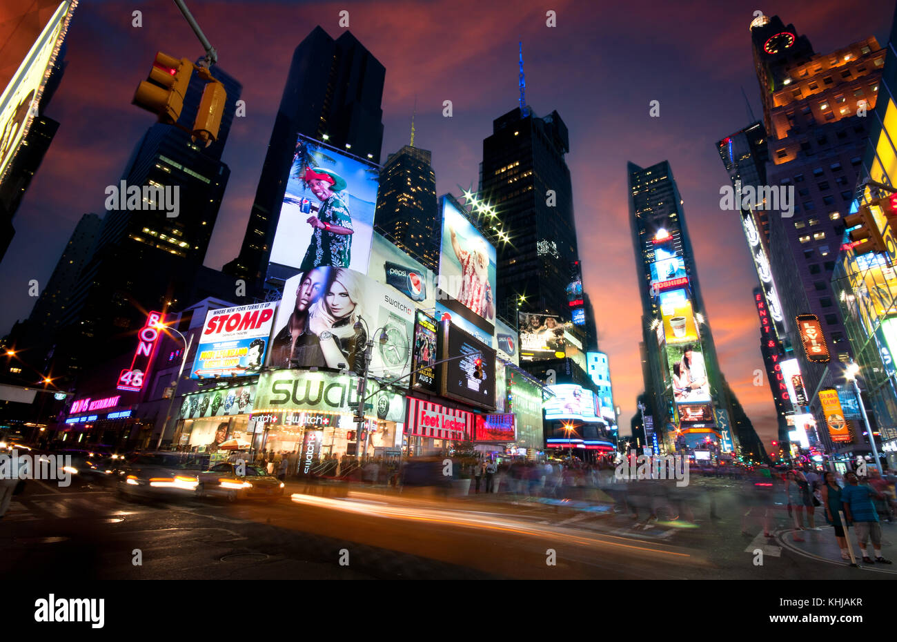 New York, USA, July 10 2011: New York Time Square in the Evening with traffic congestion human crowd and advertising - Stock Image