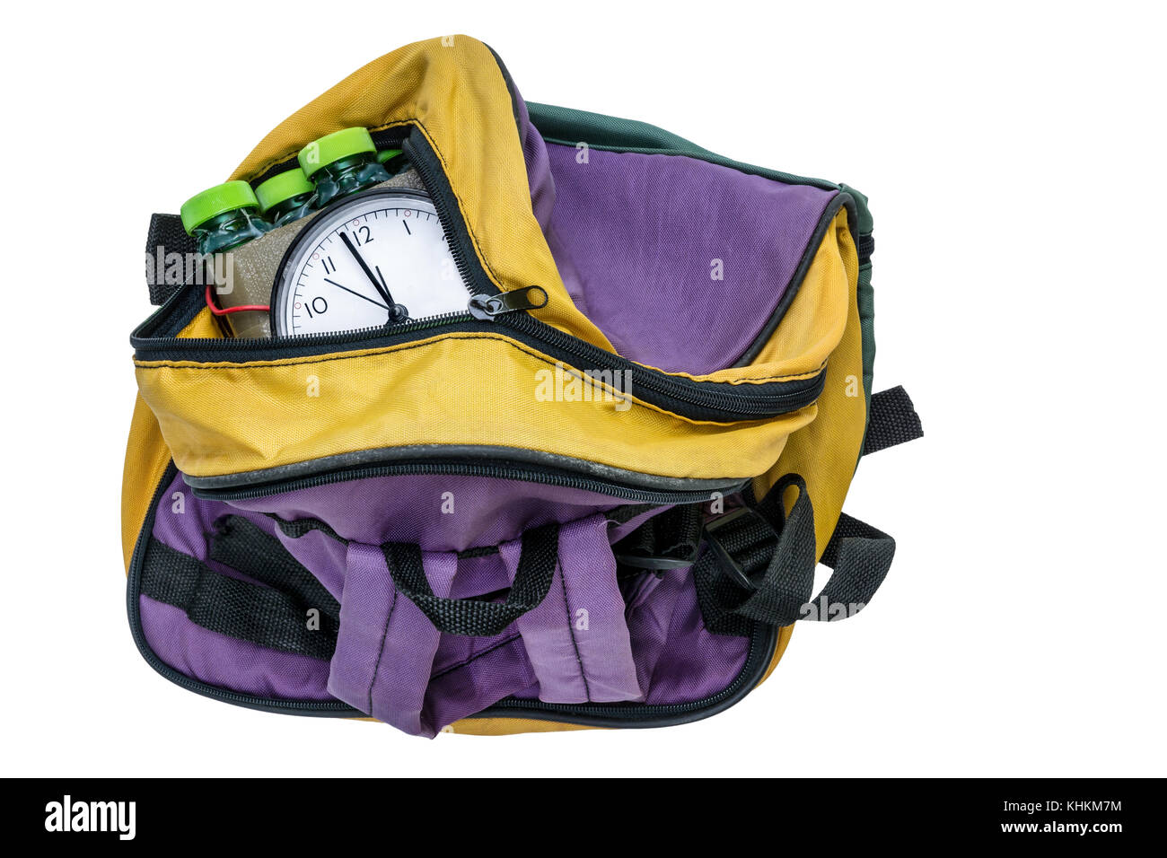 Timed bomb in colored bag. Imitation of time bomb inside the bagpack on white background. Isolated. - Stock Image