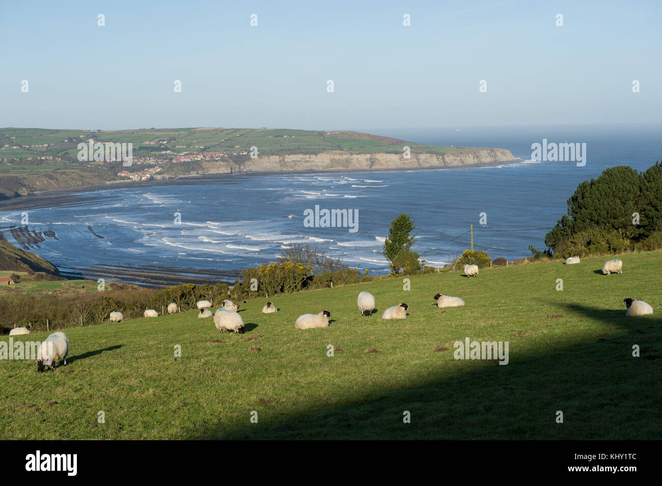 A landscape view from Ravenscar overlooking Robin Hoods Bay on the North Yorkshire coast - Stock Image