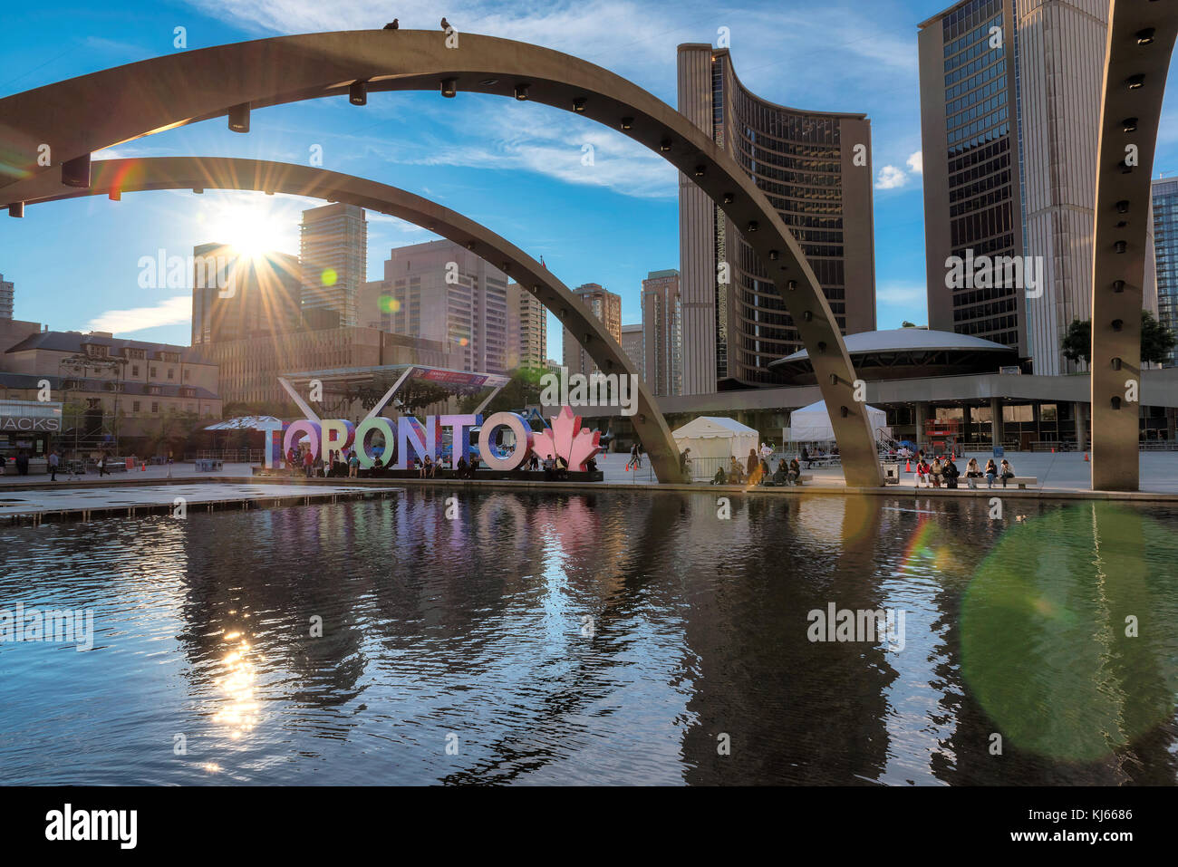 Toronto city hall and Toronto Sign in downtown at sunset - Stock Image