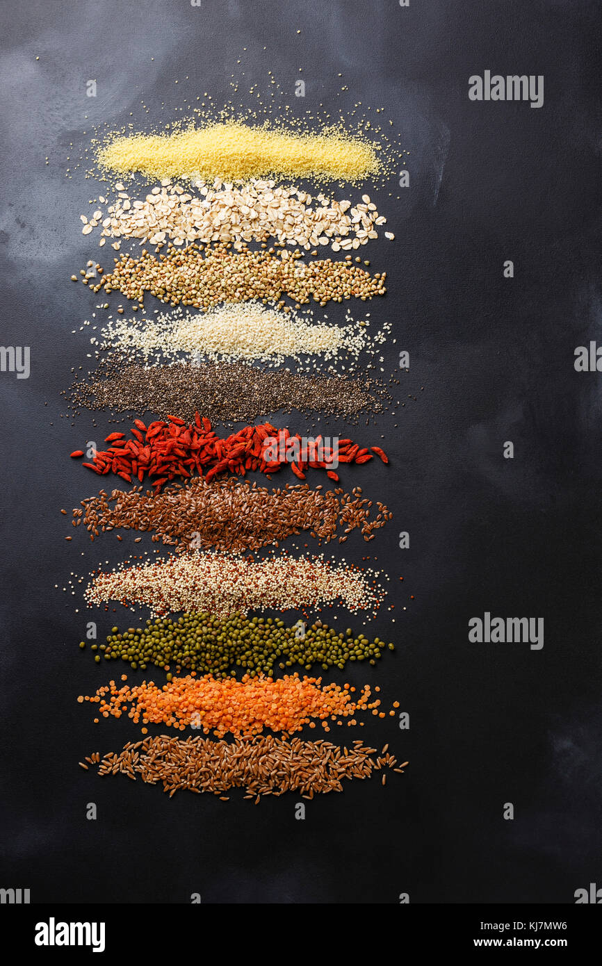 Superfoods and cereals selection for High Energy Lifestyle and Eating Right: bulgur, oat-flakes, buckwheat, sesame, - Stock Image