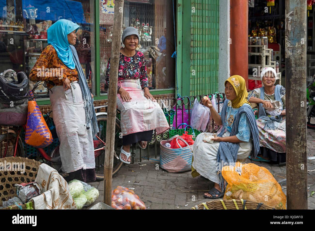 Javanese women chatting at market in Chinatown / Kampung Pecinan Semawis of the city Semarang, Central Java, Indonesia Stock Photo