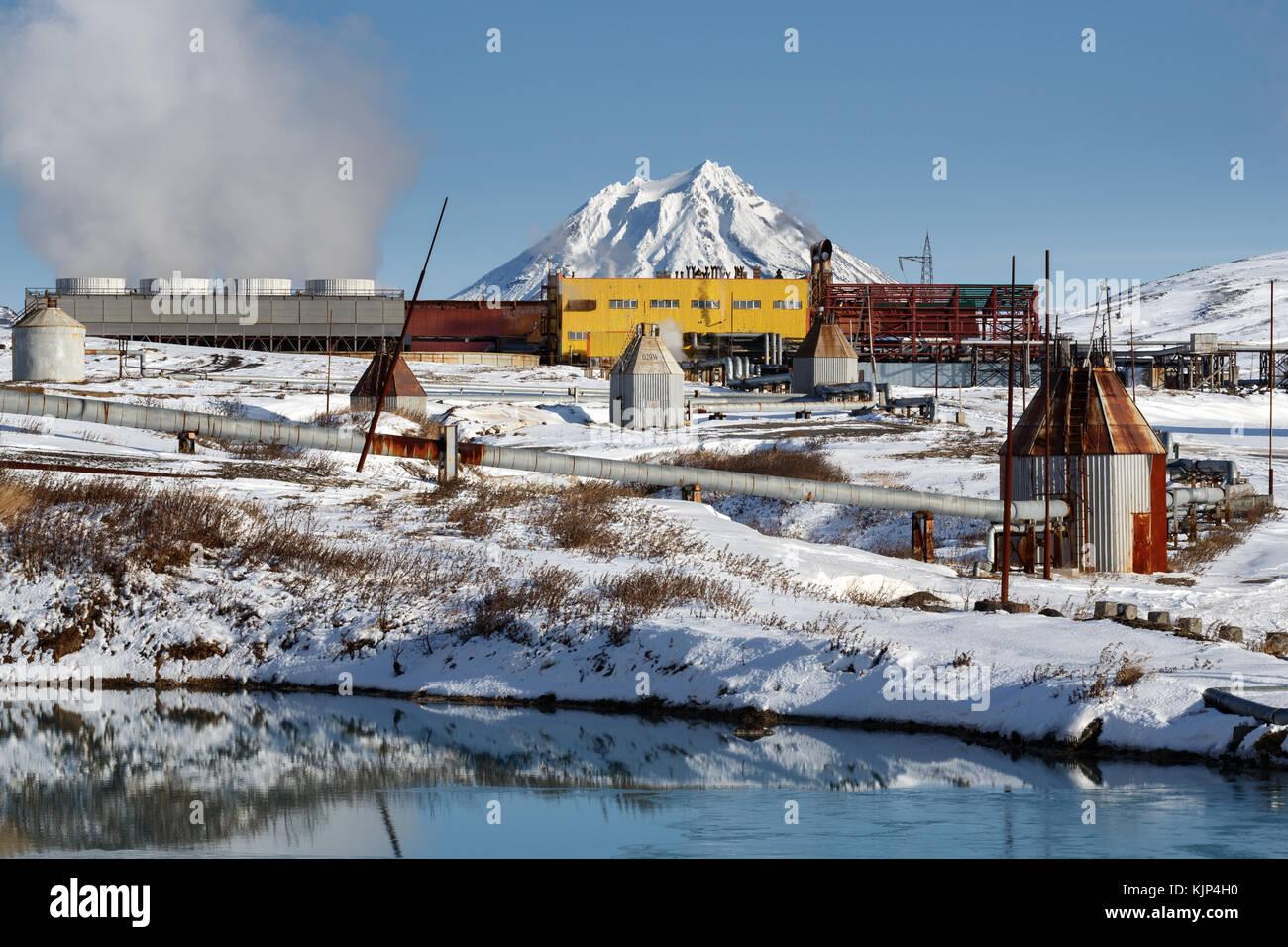 Winter view on Mutnovskaya Geothermal Power Station (Mutnovskaya GeoPP-1) Geotherm (RusHydro) using geothermal energy - Stock Image