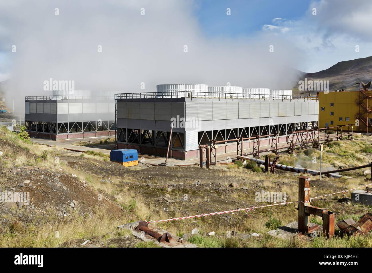 Kamchatka Peninsula, fan cooling towers of Mutnovskaya Geothermal Power Station (Mutnovskaya GeoPP-1) using geothermal - Stock Image