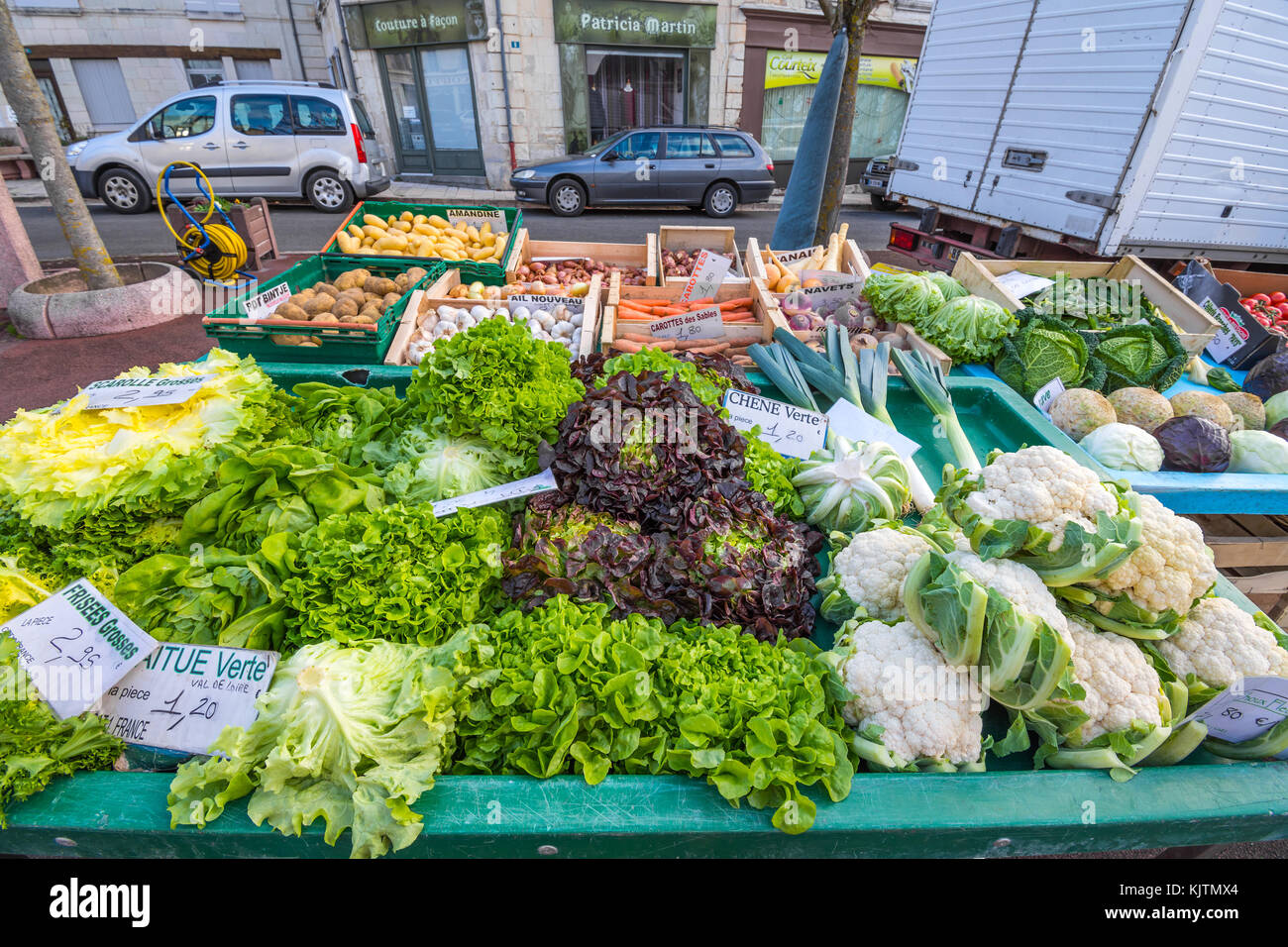 Lettuces foir sale at open-air market - France. - Stock Image