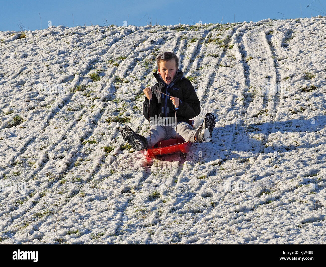 Cumbria, UK. 25th November, 2017. Sledging in Cumbria after early snowfall Credit: Steve Holroyd/Alamy Live News - Stock Image