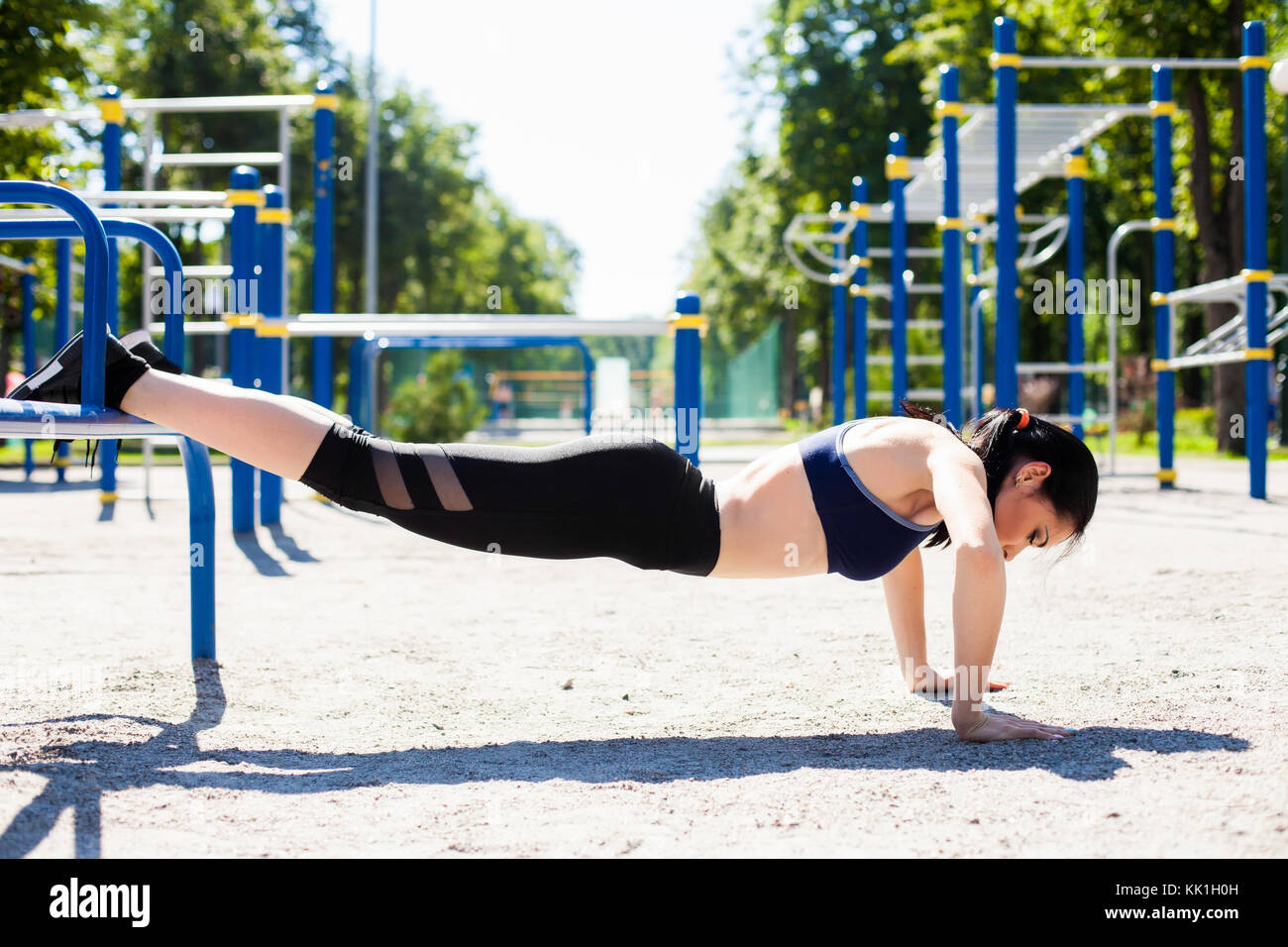 young sportive girl on sport playground - Stock Image