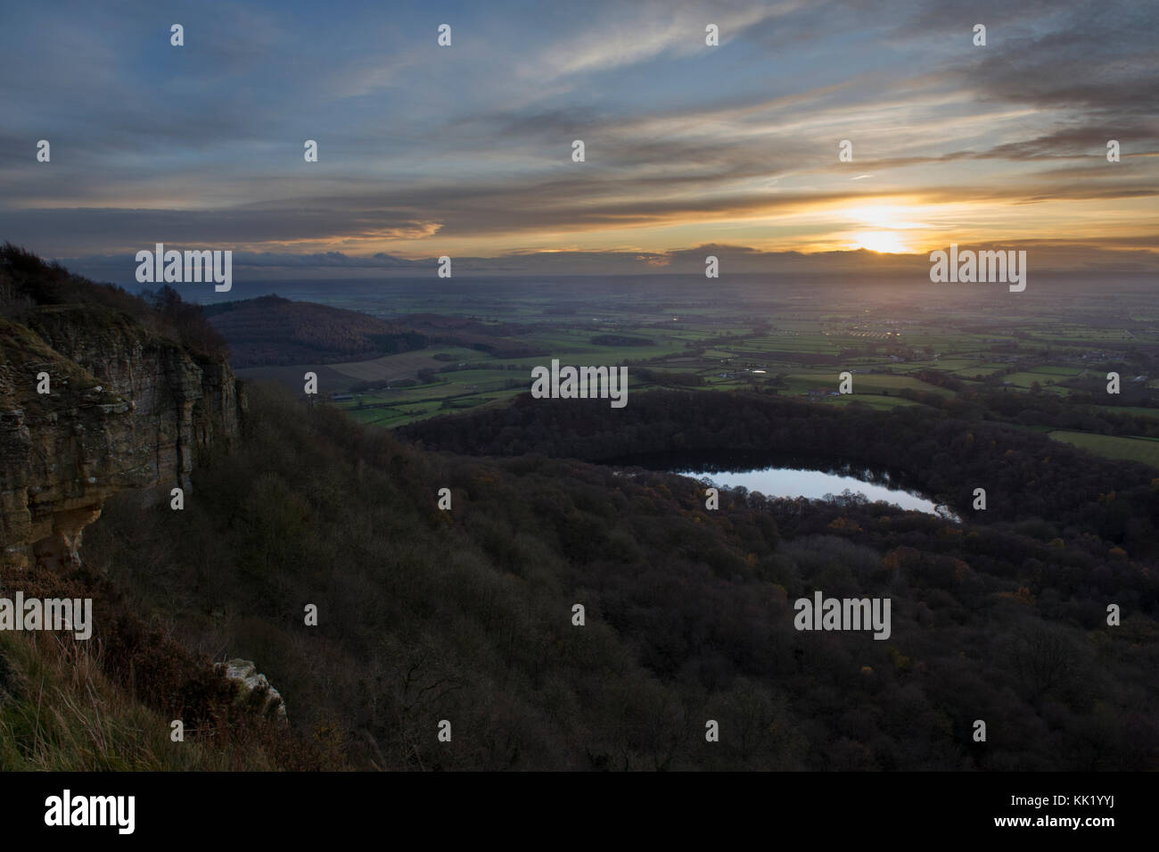 Sunset over Lake Gormire and the Vale of York taken from 'The best view in Britain' at the top of Sutton - Stock Image