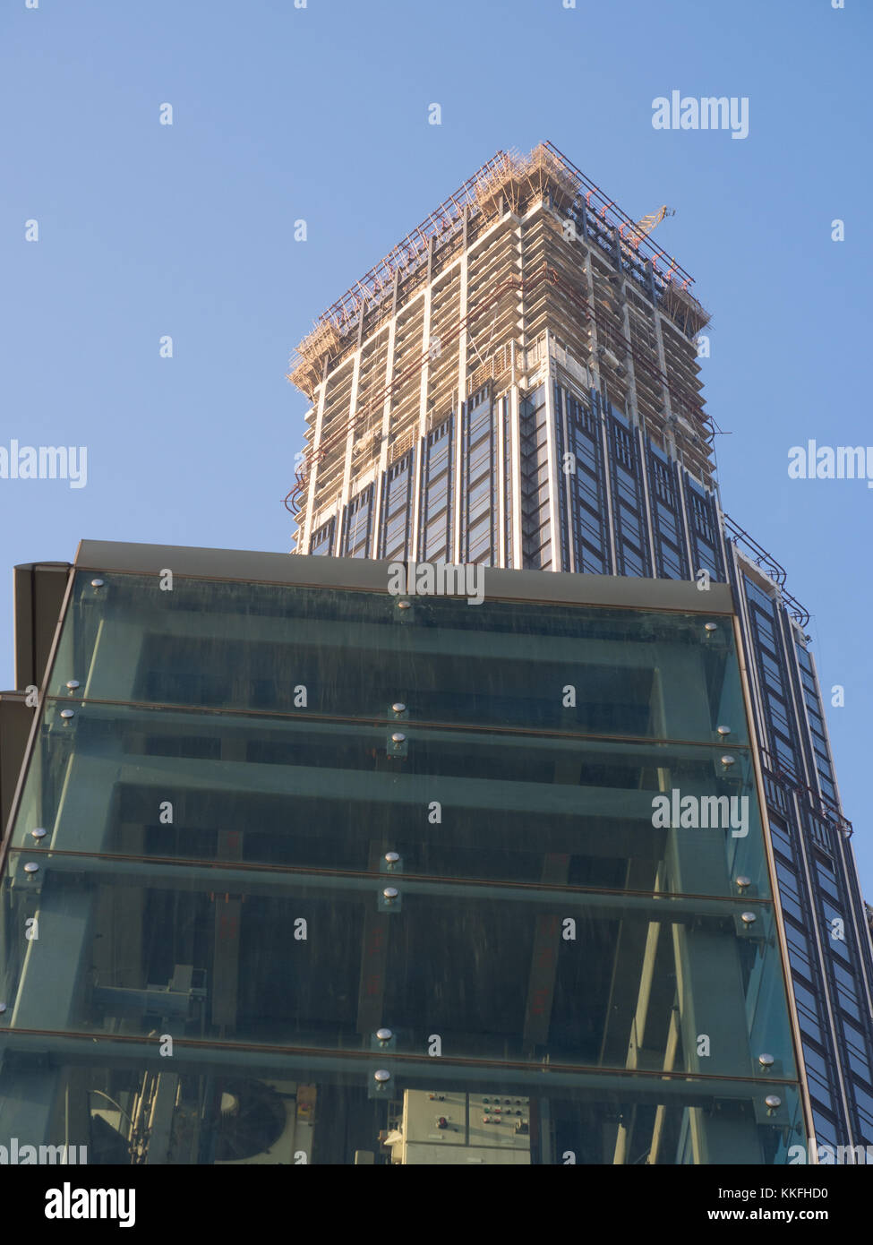 Glass Lift And Tall Building - Stock Image