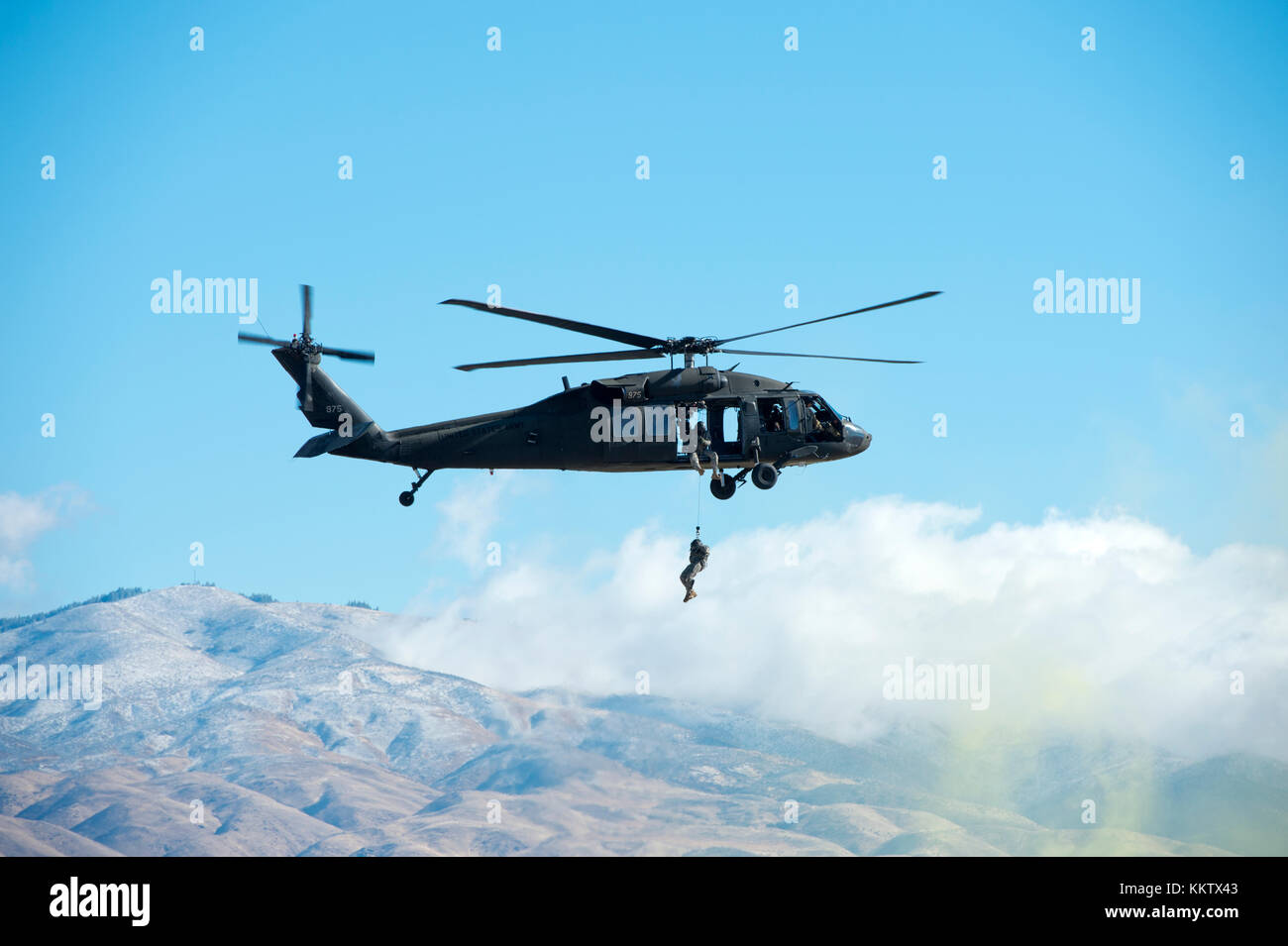 Soldier rappelling out of Black Hawk helicopter at the Gowen Thunder airshow at Gowen Field on October 14 2017 - Stock Image