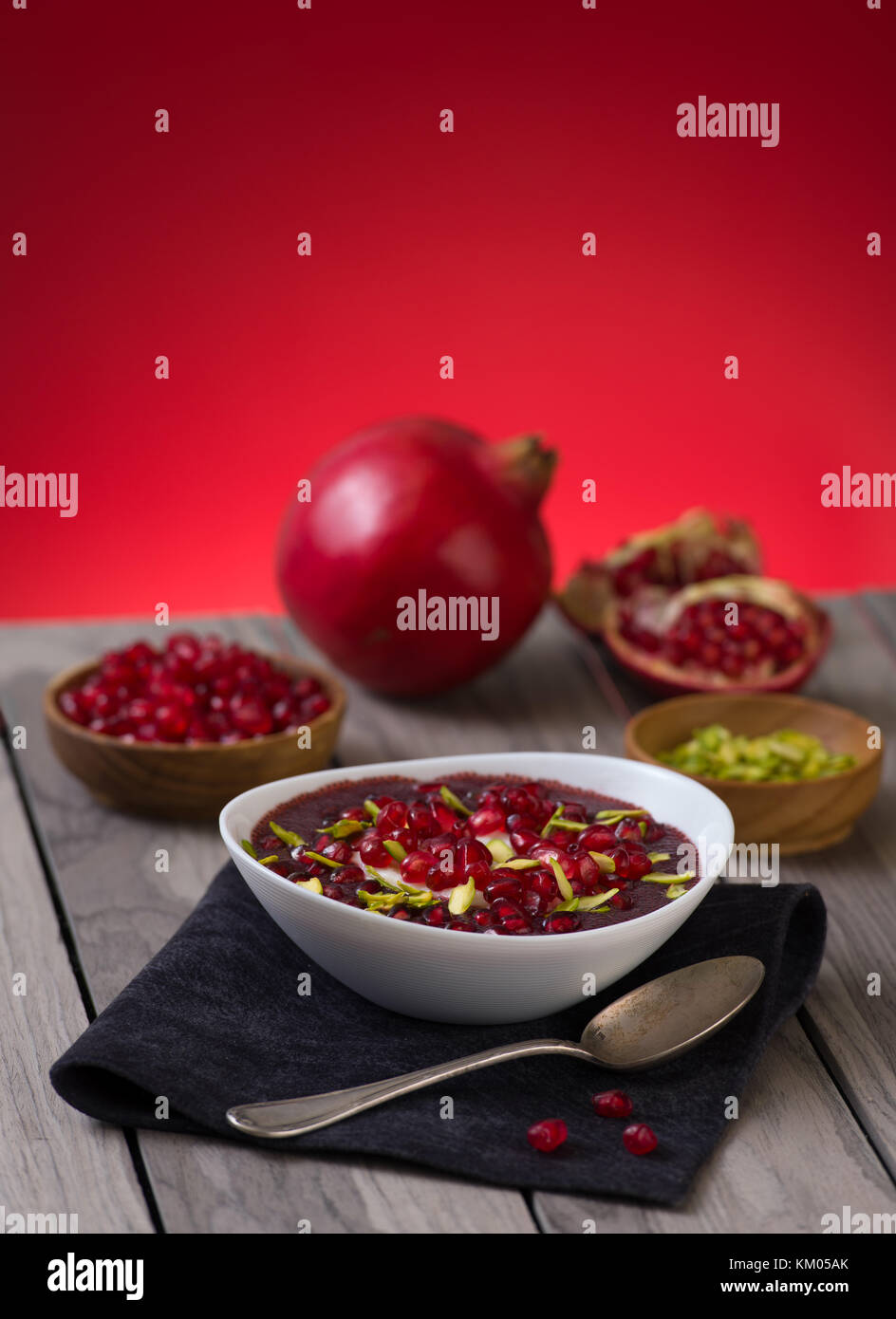 Pomegranate desert with pistachios, Chia Seed, tapioca pudding and Yogurt. healthy eating. red copy space. - Stock Image