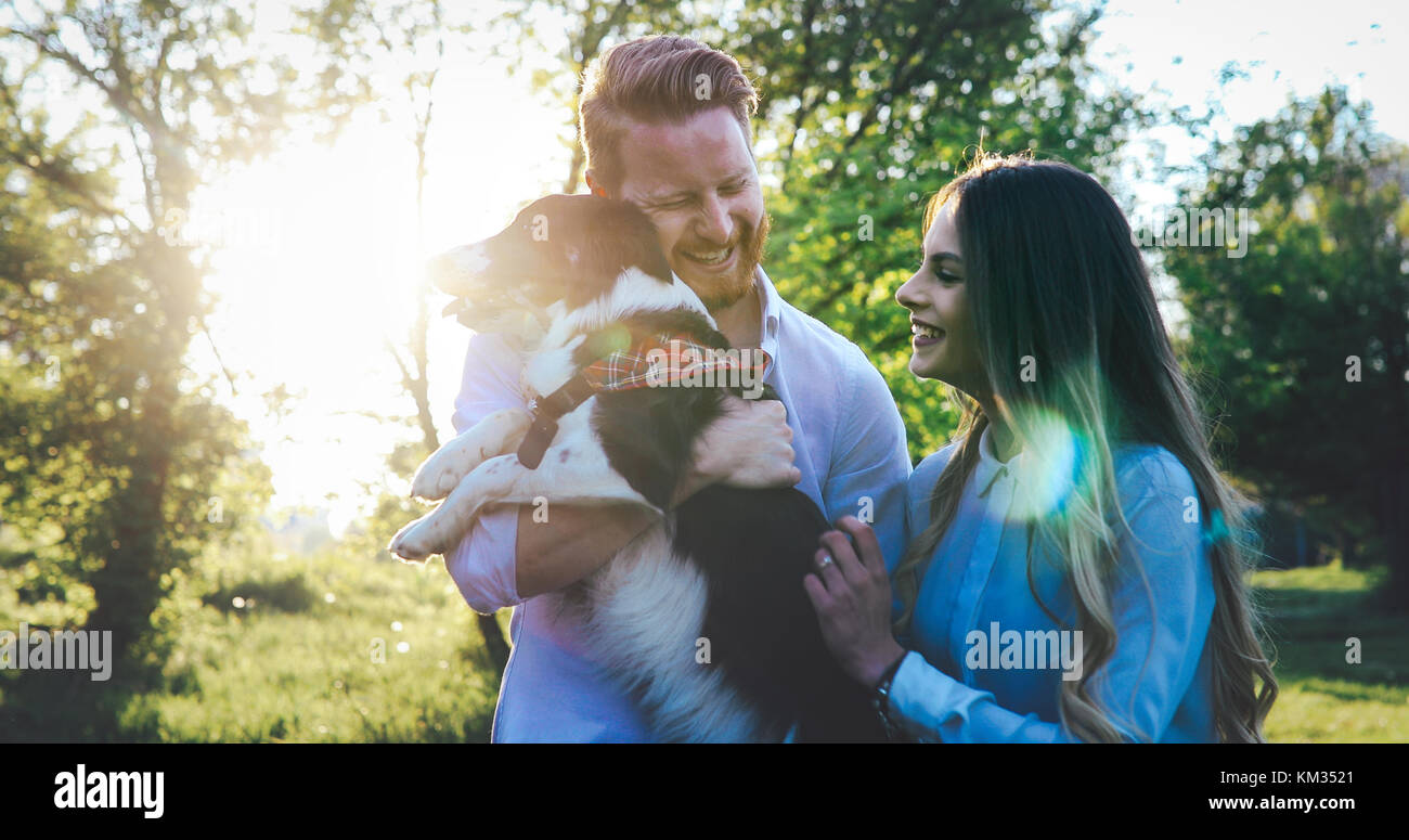 Romantic couple in love walking dogs and bonding - Stock Image
