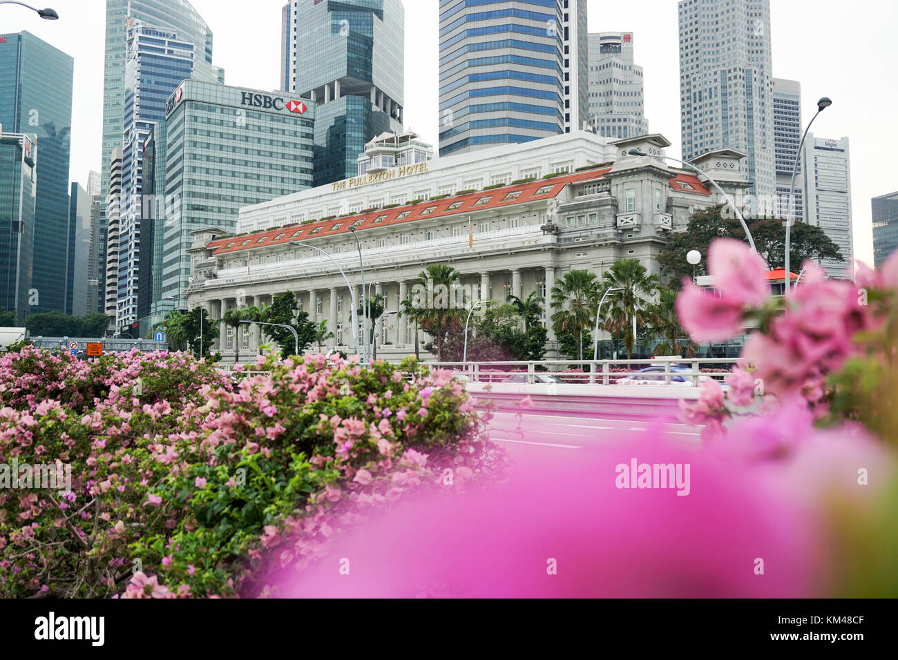 The Fullerton Hotel Singapore (previously Fullerton Building) located  near the mouth of the Singapore River. - Stock Image