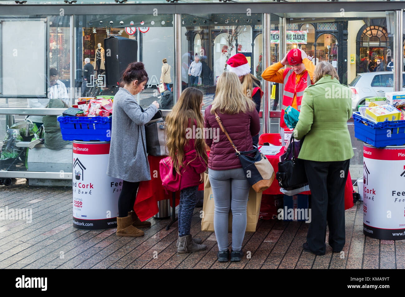 Food bank staffed by volunteers dishing out hot chocolate drinks in Patrick Street, Cork, Ireland. - Stock Image