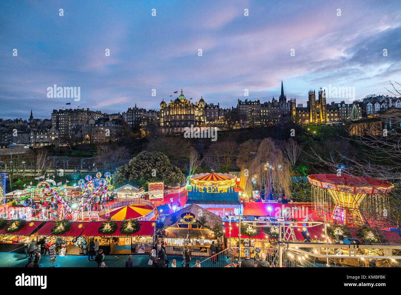 Evening view of funfair at annual Edinburgh Christmas Market in Scotland, United Kingdom Stock Photo