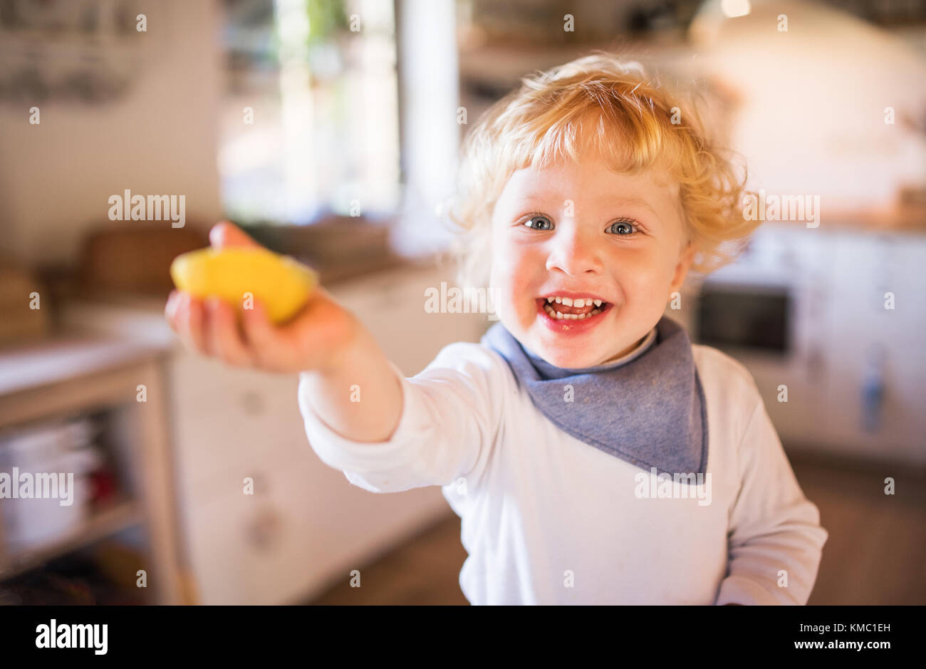 Toddler boy in the kitchen. - Stock Image