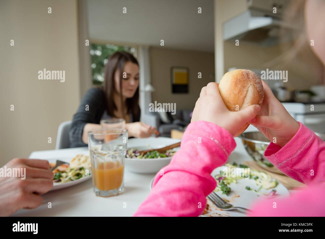 Family having breakfast in kitchen - Stock Image