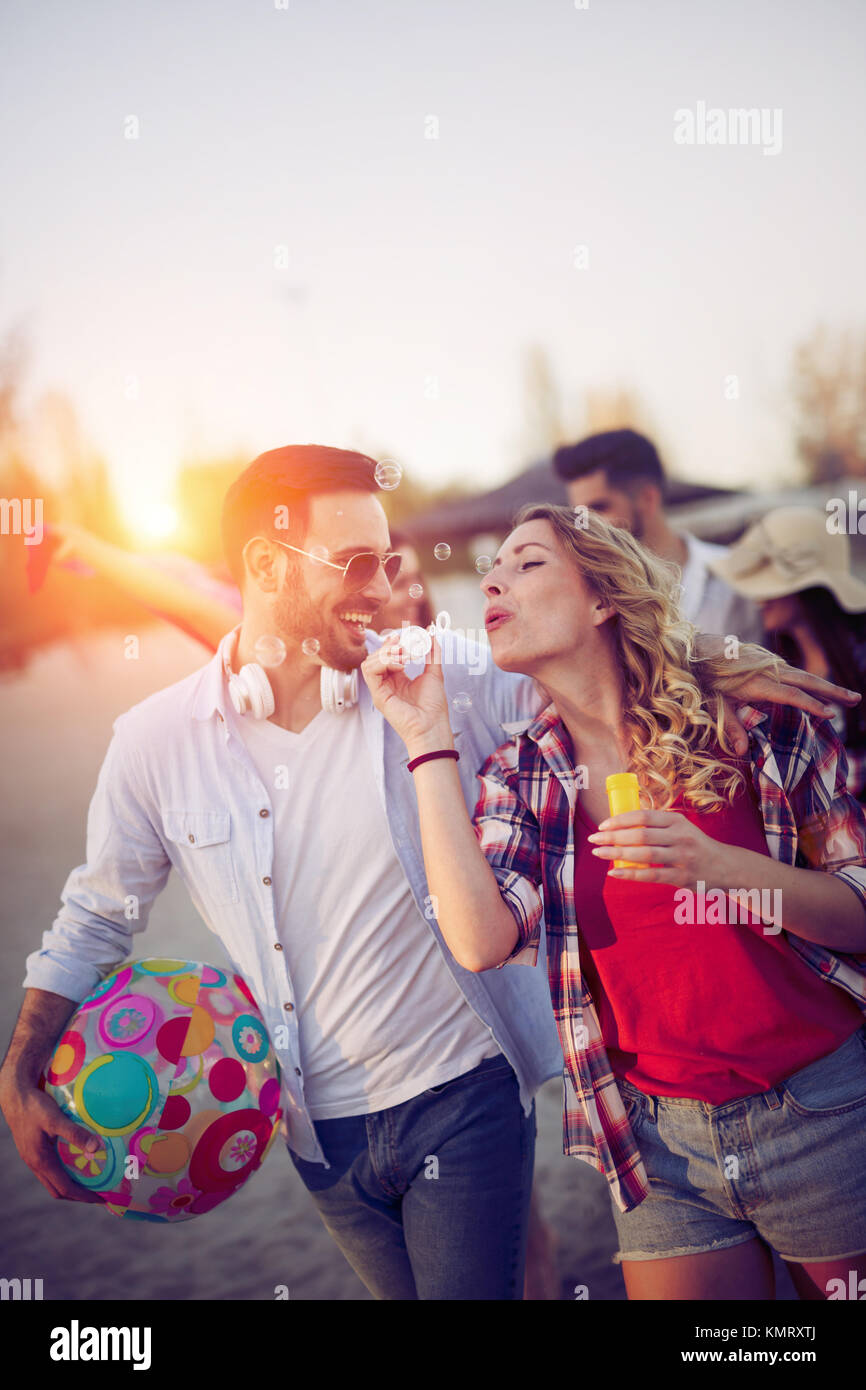 Young people having fun at beach in summer - Stock Image