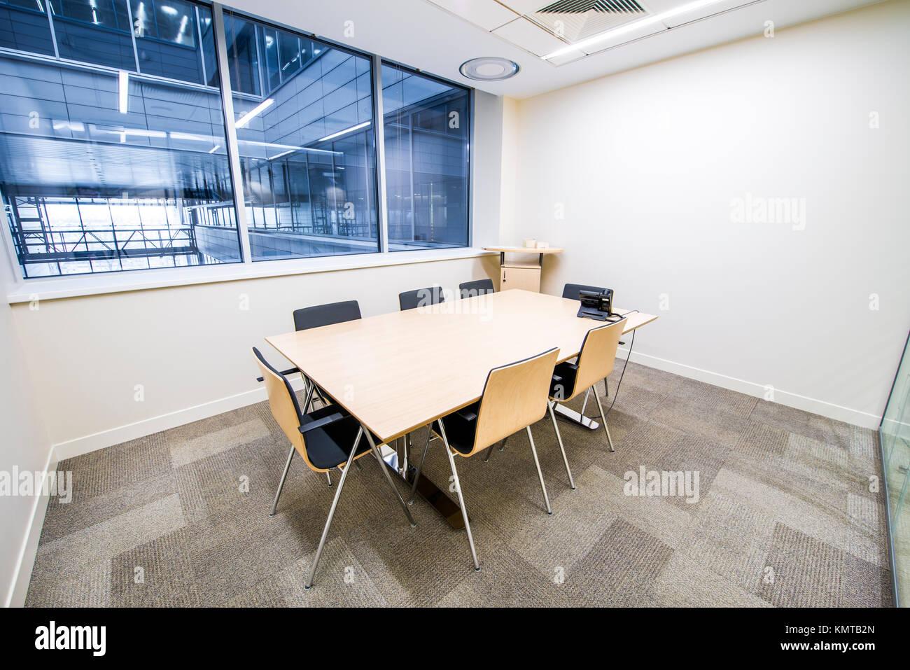 Empty small meeting room. bright modern interior. glass walls stock