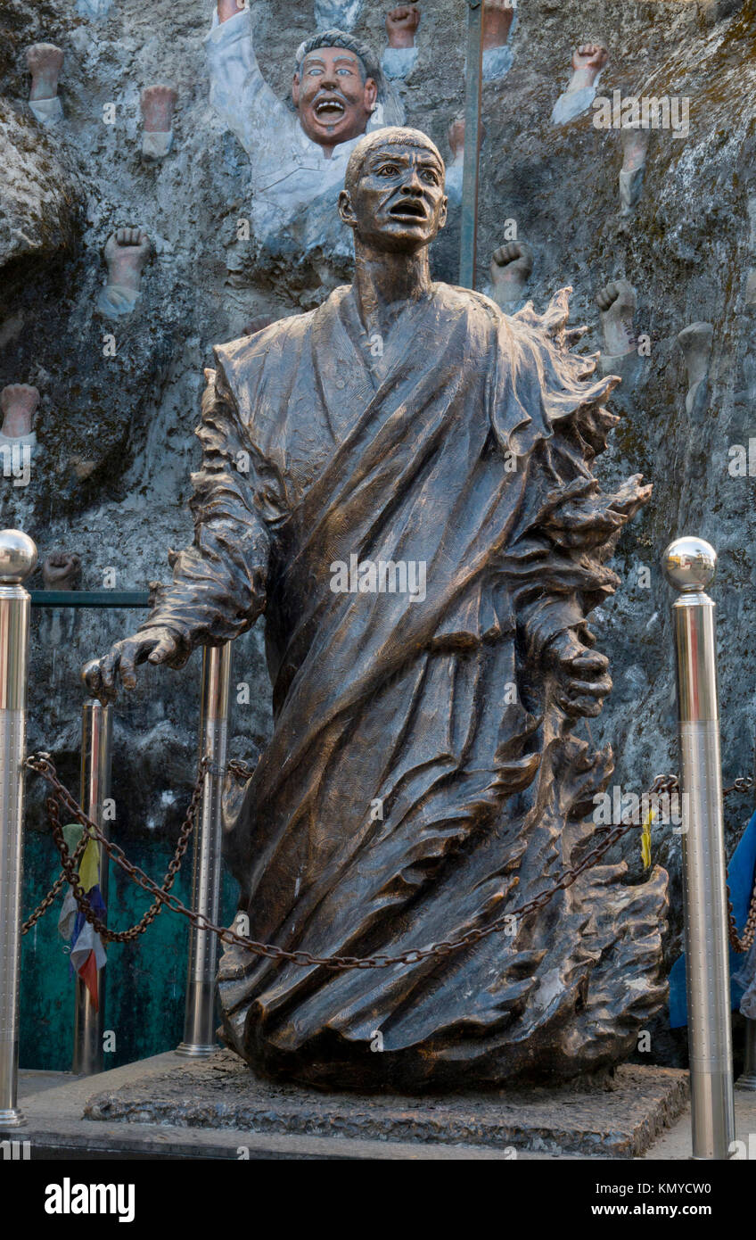 Bronze sculpture memorial at Dalai Lama temple to Tibetans who have died in self-immolations in protest of Chinese - Stock Image