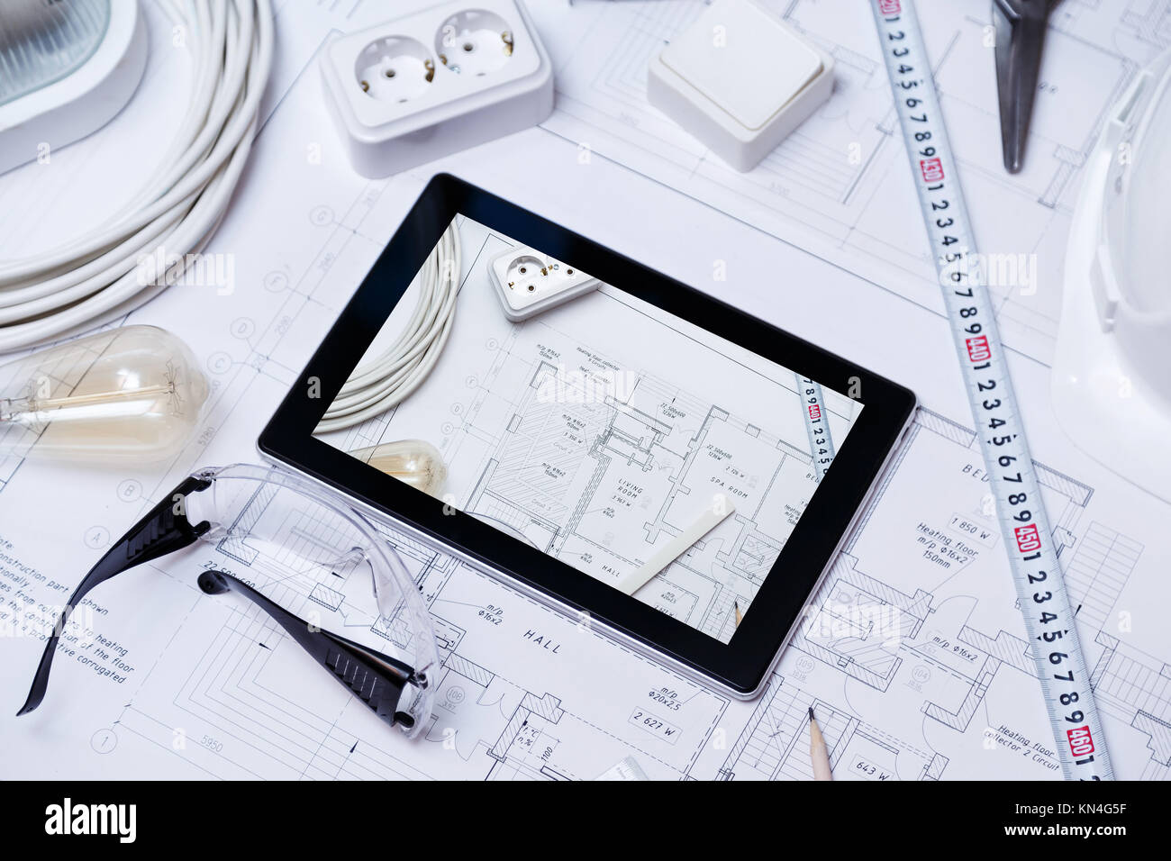 Construction drawing with tools and tablet - Stock Image