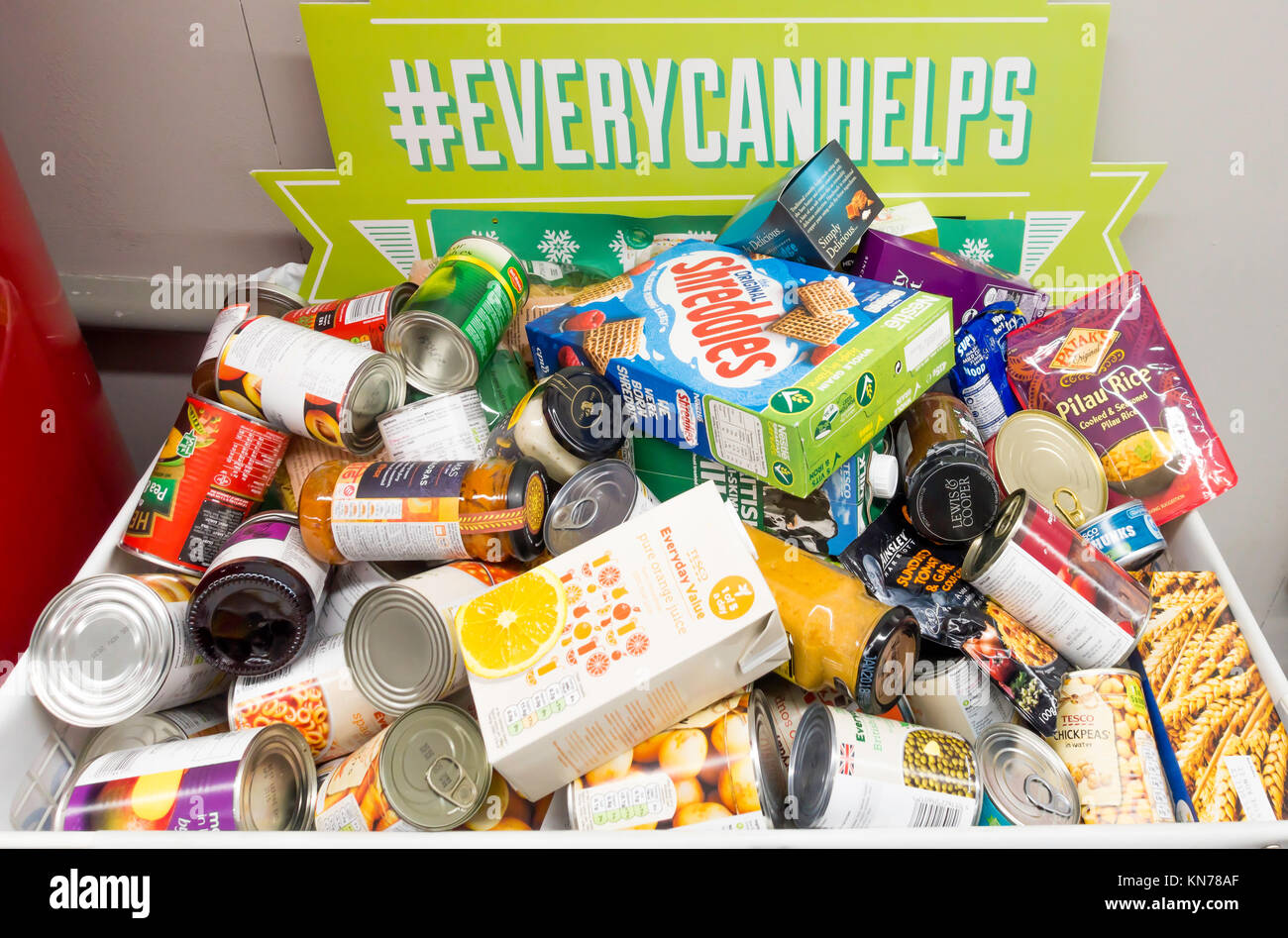 Donation box in a Supermarket to permit customers to donate food which will be given to local Food Bank charities - Stock Image
