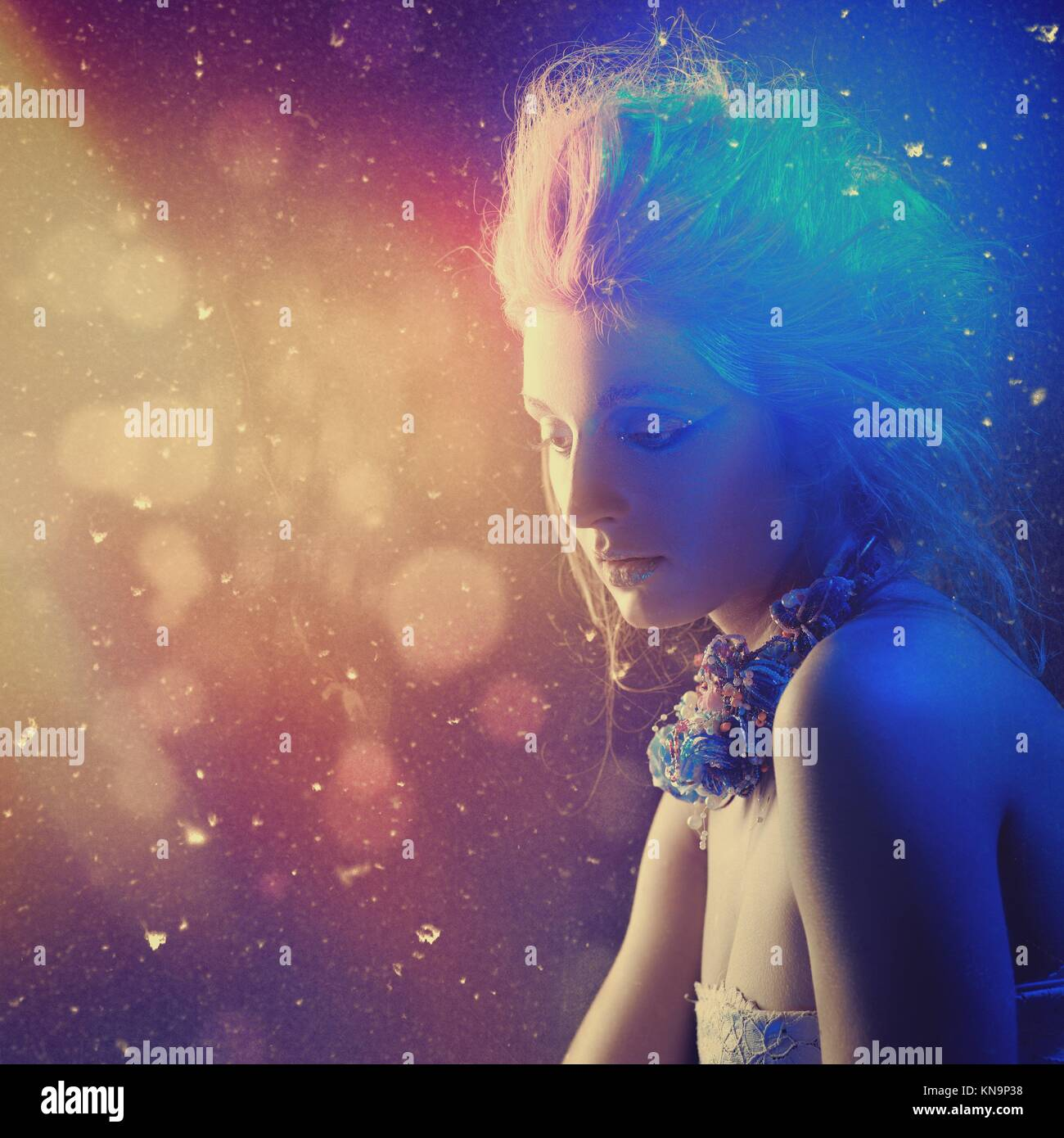 Northern Lights. Beauty female portrait with abstract light as backgrounds. - Stock Image