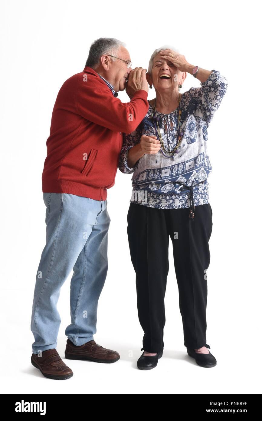 Senior couple, whispering secrets - Stock Image
