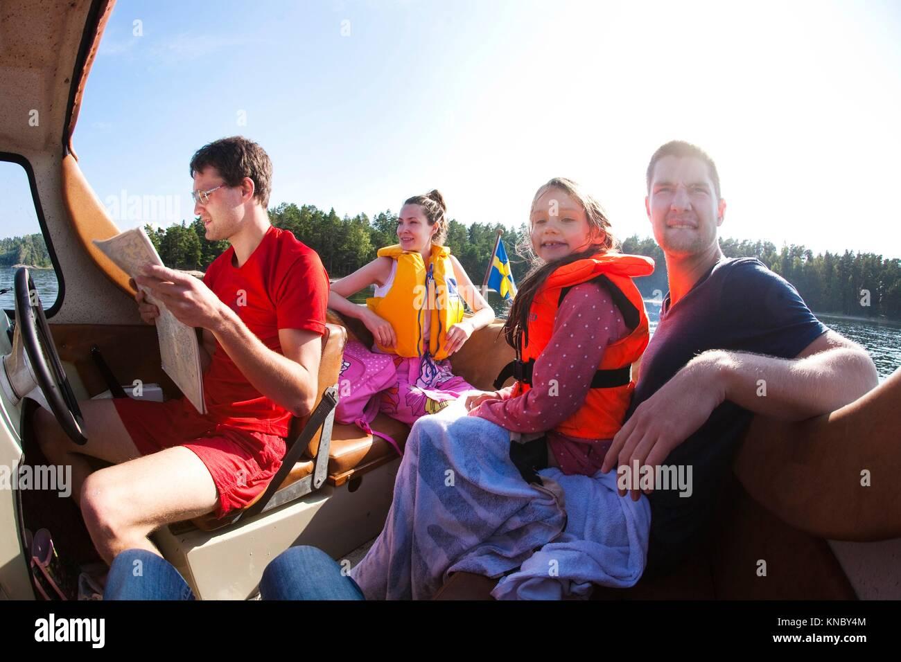 Family boat trip, Swedish archipelago. - Stock Image
