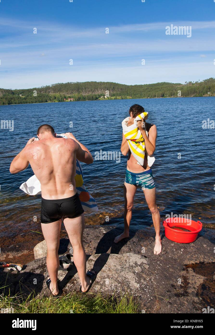 Washing by the water, Northern Sweden. - Stock Image