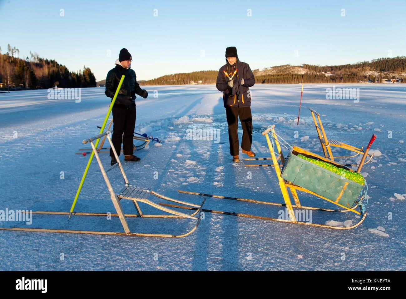 Brothers kicksledding Northern Sweden. - Stock Image