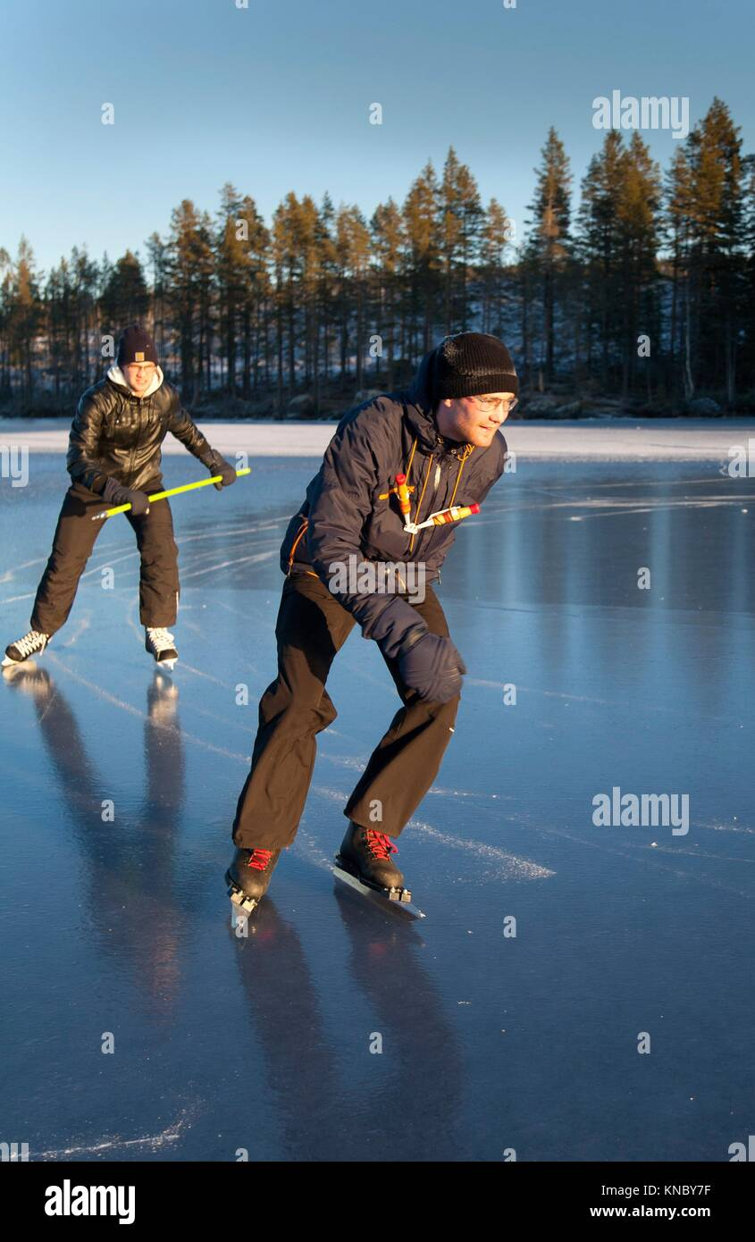 Ice skating on frozen lake Northern Sweden. - Stock Image