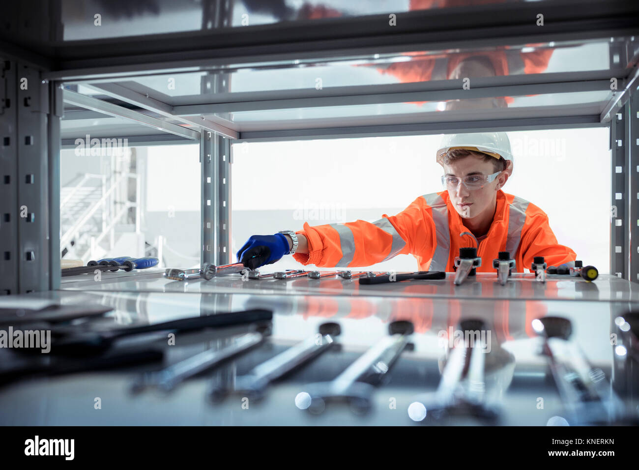 Apprentice selecting tools at railway engineering facility - Stock Image
