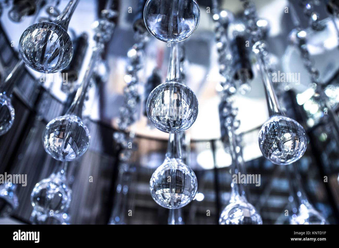 Crystal modern chandelier with hanging glass drops selective focus crystal modern chandelier with hanging glass drops selective focus arubaitofo Images