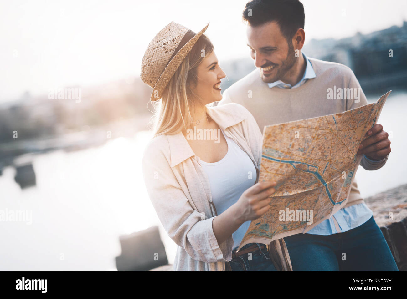 Beautiful couple traveling and sightseeing - Stock Image